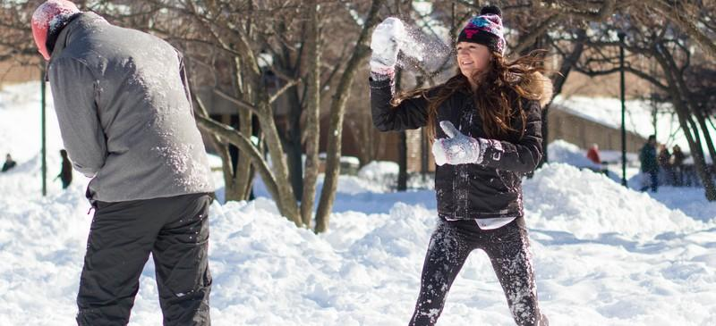 Kat Cirone, a DePaul feshman, enjoys the day off with a snowball fight in the Quad with some of her friends from University Hall. (Grant Myatt / The DePaulia)