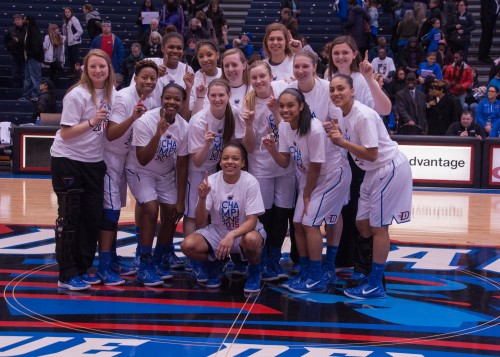 DePaul women's basketball poses at half-court following their 99-82 win Sunday  for clinching their second consecutive regular season Big East title. (Maggie Gallagher/ The DePaulia)