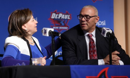 DePaul University's athletic director Jean Lenti Ponsetto introduces Dave Leitao during a news conference to announced him as their new basketball head coach Monday, March 30, 2015, at the DePaul Student Center in Chicago. Leitao is charged with a big task as he tries to revitalize a struggling program and get it back at least to the level when he led the Blue Demons from 2002 to 2005. (AP Photo/Chicago Tribune, Brian Cassella)