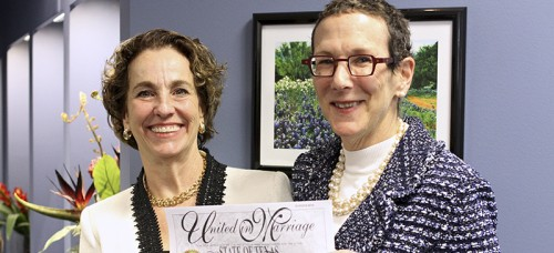 Suzanne Bryant (left) and Sarah Goodfriend hold up their marriage license after a press conference Feb. 19. They became the first same-sex couple to marry in Texas on Thursday morning. (Mariana Munoz | AP)