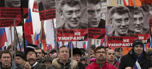 People march in support of Boris Nemtsov, a vocal critic of President Vladimir Putin who was recently killed. Some suspect political motivation behind Nemtsov's killing. (PAVEL GOLOVKIN | AP)