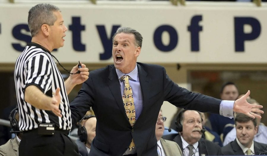 Pitt head coach Jamie Dixon argues for a shot clock violation against Georgia Tech to referee Tim Nestor in the second half at the Petersen Events Center in Pittsburgh on Saturday, Jan. 17, 2015. Pitt won, 70-65. (Matt Freed/Pittsburgh Post-Gazette/TNS)