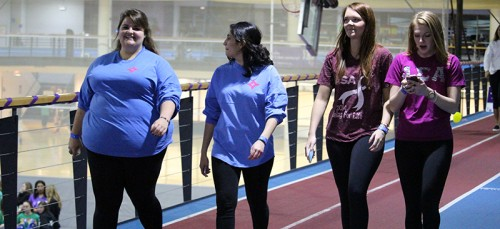 Kathleen Ashenden walk (L) with (L-R) Maria Paleologos, Kylen Schmitz and Christine Jeavons at Relay for Life and said everyone knows someone who has been affected by cancer.  Both Ashenden and Paleologos had friends who died from cancer. (Megan Deppen / The DePaulia)