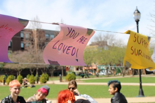 Positive messages hang in the quad to send sexual assault survivors hope and healing. The 2nd annual Carry the Weight event supported survivors on campuses around the U.S. (Megan Deppen / The DePaulia)