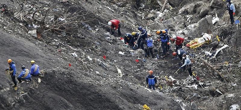 Rescue workers clear the Germanwings Flight 9525 crash site in the French Alps. Despite publicization of flight crashes, the probability of being in one remains near-nil. (AP Photo/Laurent Cipriani, File)
