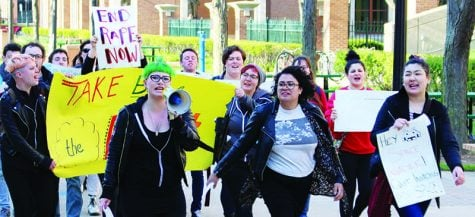 Protesters march Thursday evening in the annual Take Back the Night rally. (Erin Yarnall/The DePaulia)