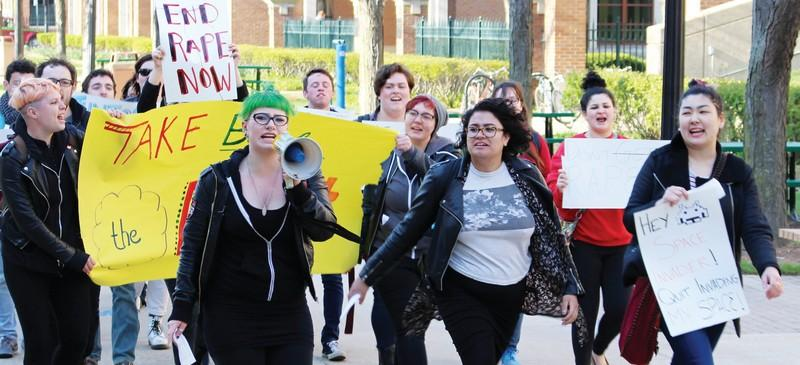 (From left) Laura Springman, Kara Rodriguez and Adina Babaian lead DePaul's annual Take Back the Night march Thursday. (Erin Yarnall / The DePaulia)