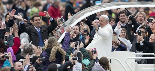Pope Francis rides through adoring crowds after mass on Easter Sunday on April 5 . The Argentine, known for riding in cost efficient cars and staying in simple apartments, will address the United States Congress in September about environmental issues. (AP Photo/Andrew Medichini)