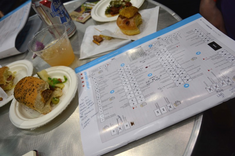 Emily Wolkowitz plots her Baconfest strategy on the festival map (Kathryn Eardley / The DePaulia)