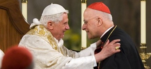 Pope Benedict XVI embraces Cardinal Francis George after addressing the bishops at the Basilica of the National Shrine of the Immaculate Conception in Washington. Cardinal Francis George, a vigorous defender of Roman Catholic orthodoxy who played a key role in the church's response to the clergy sex abuse scandal, has died. (AP Photo/J. Scott Applewhite)
