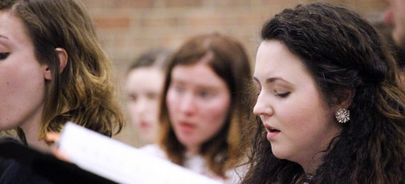Christine Roberts practices during opera choral rehearsal April 15. Oftentime, voice students wait before beginning graduate school because the voice takes years to mature to its full potential. (Kirsten Onsgard / The DePaulia)