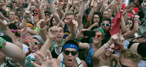 Fans dance at Spring Awakening Music Festival in 2014. Some criticize the genre's culture and artists for proliferating sexism and objectifying women. (DePaulia File)