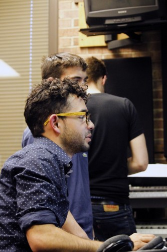 Zach Yanez and members of one of his bands, Just, mix a song that will be submitted to DePaul Activities Board's Battle of the Bands competition. (Kirsten Onsgard / The DePaulia)