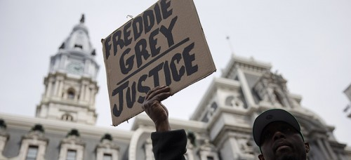 A demonstrator outside City Hall in Philadelphia on April 30. The event in Philadelphia follows days of unrest in Baltimore after Freddie Gray's police-custody death. (AP Photo/Matt Rourke)