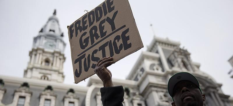 A demonstrator outside City Hall in Philadelphia on April 30. The event in Philadelphia follows days of unrest in Baltimore after Freddie Grays police-custody death. (AP Photo/Matt Rourke)