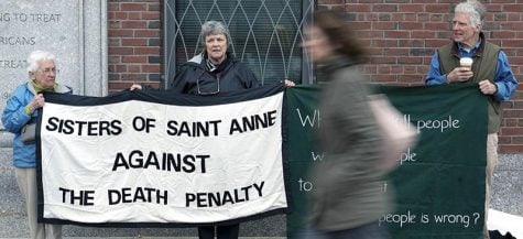 Protestors stand outside the trial of surviving Boston Marathon bomber Dzhokhar Tsarnaev. Many in the Christian community have driven anti-death penalty activism, despite common labeling as conservatives. (AP Photo/Justin Saglio)