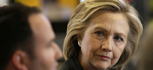 Democratic presidential candidate Hillary Rodham Clinton listens to Brad Magg, owner of Goldie's Ice Cream Shoppe and Magg Family Catering, as she meets with small business owners,Tuesday, May 19, 2015, at the Bike Tech cycling shop in Cedar Falls, Iowa. (AP Photo/Charlie Neibergall)
