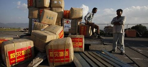 Boxes of aid from the Chinese Red Cross arrive in Nepal. (AP Photo/Niranjan Shrestha)