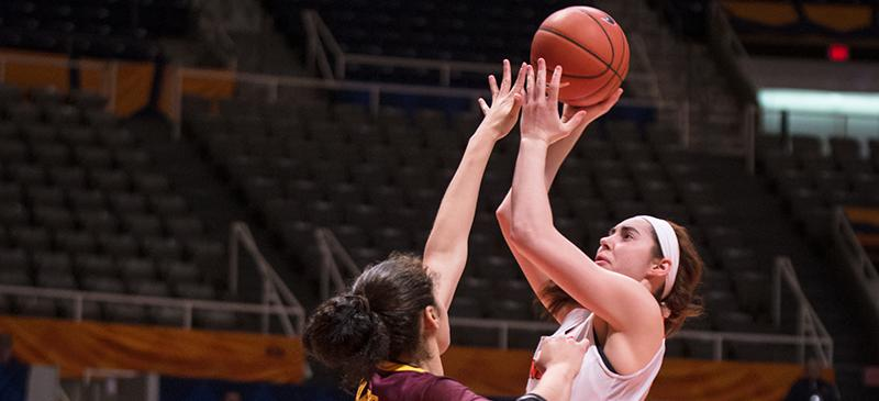 Illinois Jacqui Grant (34) attempts a contested jump shot during the match against Minnesota at the State Farm Center on Thursday, Feb. 5, 2015.The Illini won 95-69. (Sonny An | The Daily Illini)