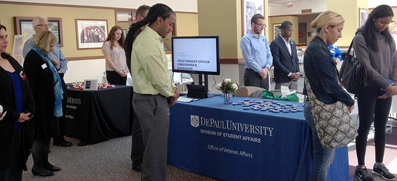 Attendees to the Memorial Day event in the DePaul Center Thursday have a moment of silence to remember soldiers who have served. (Luisa Fuentes / The DePaulia)
