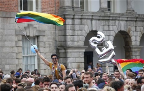 "Yes supporters celebrate at Dublin castle, Ireland, Saturday, May 23, 2015. Ireland has voted resoundingly to legalize gay marriage in the world's first national vote on the issue, leaders on both sides of the Irish referendum declared Saturday even as official ballot counting continued. Senior figures from the ""no"" campaign, who sought to prevent Ireland's constitution from being amended to permit same-sex marriages, say the only question is how large the ""yes"" side's margin of victory will be from Friday's vote. (AP Photo/Peter Morrison)"