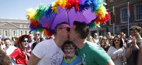 Two Irish men kiss in celebration of the referendum results approving of gay marriage in their country Saturday, May 23. (AP Photo/Peter Morrison, FILE)