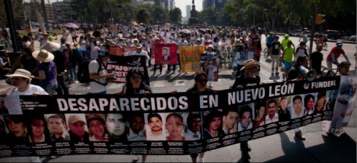 "People in Mexico City demonstrate in solidarity for the ""disappeared,"" a number of citizens whom have gone missing in Mexico's War on Drugs, allegedly due both to drug cartels and corrupt police forces. (Marco Ugarte 