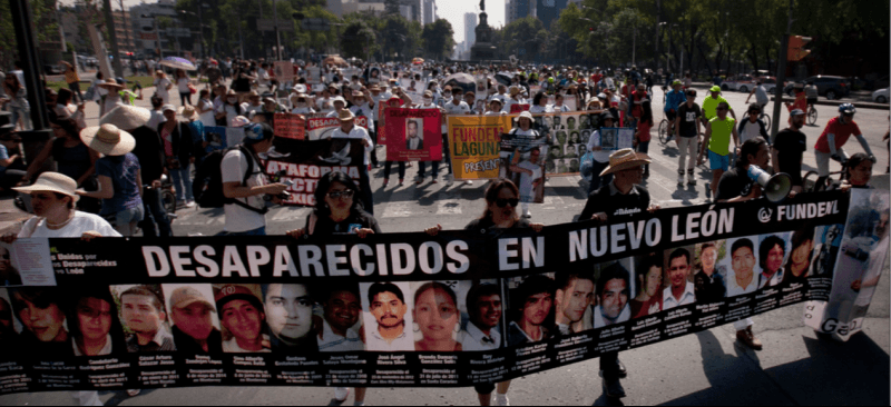 People in Mexico City demonstrate in solidarity for the disappeared, a number of citizens whom have gone missing in Mexicos War on Drugs, allegedly due both to drug cartels and corrupt police forces. (Marco Ugarte | AP)