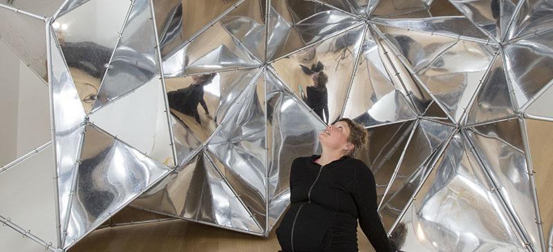 """Sonja Thomsen poses with """"Trace of Possibility"""" at the DePaul Art Museum May 14. (DePaul University/Jamie Moncrief)"""