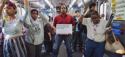 "People from DePaul joined the larger Chicago community to engage in a ""Train Takeover"" protest on Friday, May 15, highlighting issues about African-American and civil rights. (Olivia Jepson / The DePaulia)"