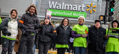 Wal-Mart workers and supporters block Jefferson Street as they protest in front of Wal-Mart Neighborhood Market on Nov. 28 in the West Loop in Chicago. (Zbigniew Bzdak/Chicago Tribune/TNS)