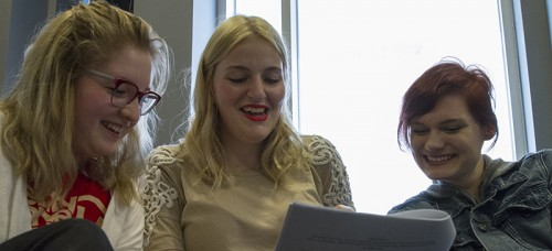 The Theatre School students Shea Corpora, Kaysie Bekkela and Emily Witt work together during a playwrighting class taught by Dean Corrin. (Geoff Stellfox / The DePaulia)