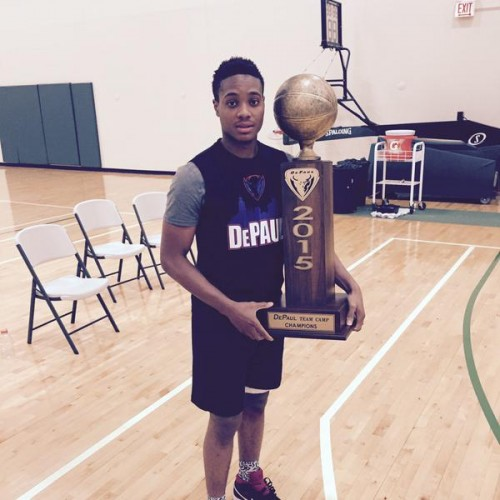 Curie point guard  Devin Gage holds the DePaul Team Camp MVP trophy. Gage committed to the Blue Demons on Friday.  (Photo courtesy of Twitter)