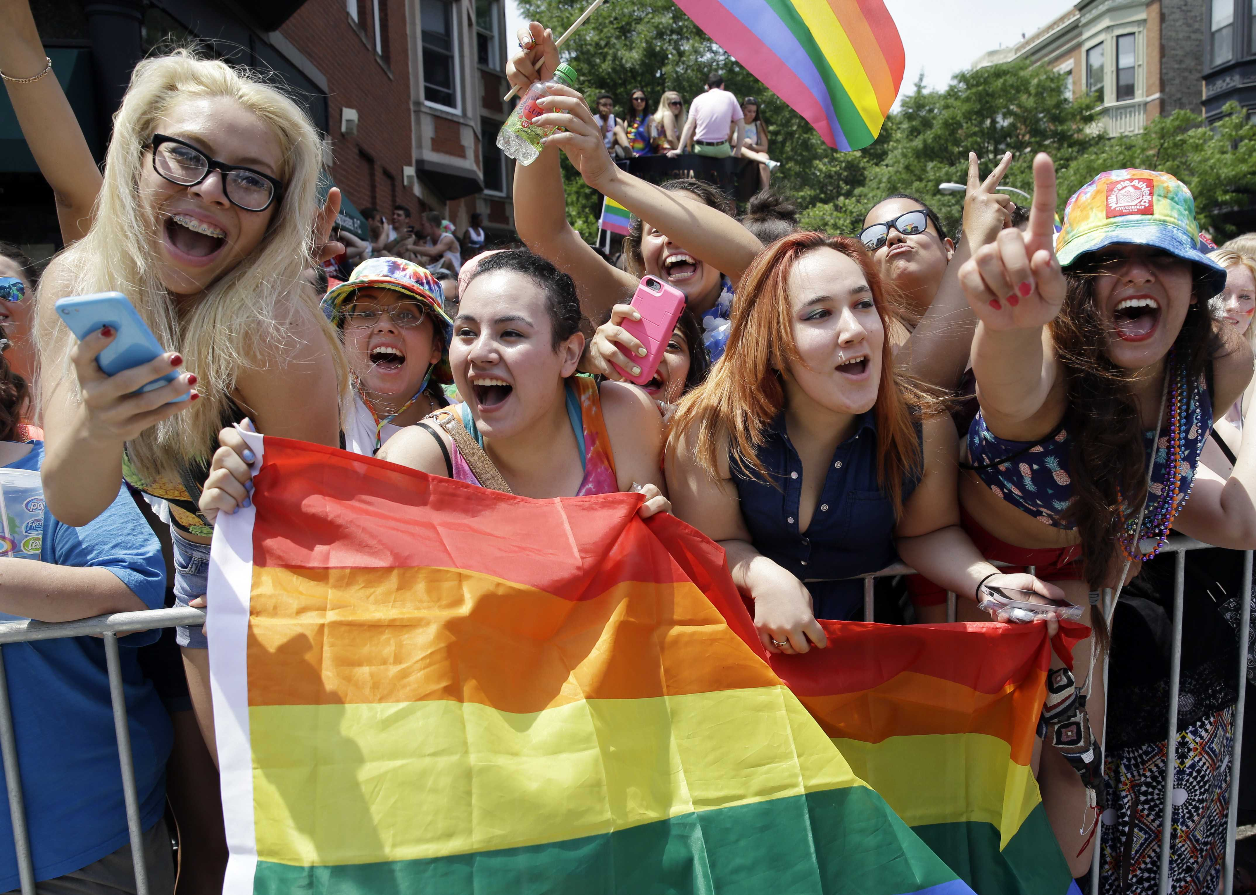 People celebrate at the 46th Annual Chicago Pride Parade, Sunday, June 28, 2015, in Chicago. A large turnout was expected for gay pride parades across the U.S. following the landmark Supreme Court ruling that said gay couples can marry anywhere in the country. (AP Photo/Nam Y. Huh)