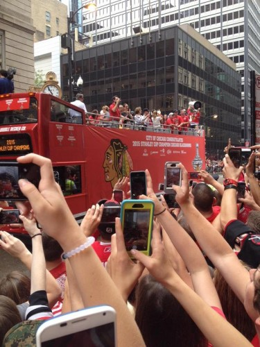 Blackhawks fans cheer on the team during a downtown parade June 18. (Megan Deppen / The DePaulia)