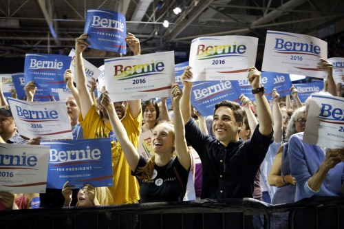 In this July 6, 2015, photo, supporters of Democratic presidential candidate Sen. Bernie Sanders, I-Vt., cheer at a campaign rally in Portland, Maine. Sanders is packing 'em in: 10,000 people in Madison, Wisconsin. More than 2,500 in Council Bluffs, Iowa. Another 7,500 this week in Portland. The trick for the independent senator from Vermont is to turn all that excitement into something more than a summer fling.(AP Photo/Robert F. Bukaty)