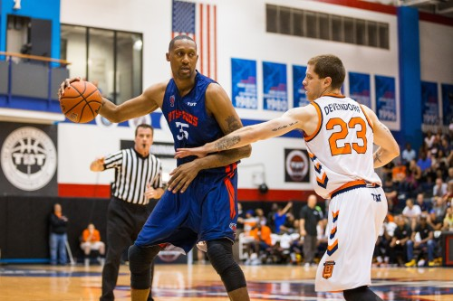 Former NBA forward and Cincinnati star DeMarr Johnson (left) posts up Boeheim's Army Saturday at McGrath-Phillips Arena. Johnson played for City of Gods in The Tournament, a single-elimination tournament for a chance at $1 million.