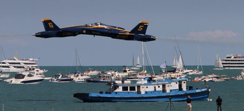 U.S. Navy Blue Angels jets pass each other travelling in opposite directions at low altitude over boats bobbing in Lake Michigan during the Chicago Air and Water Show at North Avenue Beach in Chicago, Illinois, on Saturday, August 18, 2012. (Armando L. Sanchez/Chicago Tribune/MCT)