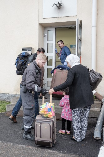Asylum seekers queue up as they arrive at a refugee reception centre in the northern town of Tornio, Finland, on Friday Sept. 25, 2015. According to current official predictions, about 30,000 asylum seekers will arrive in Finland this year, compared to 3,651 last year. (Panu Pohjola/Lehtikuva via AP) FINLAND OUT - NO SALES