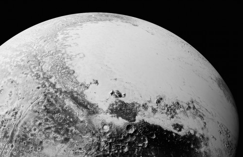 This July 14, 2015, photo provided by NASA shows a synthetic perspective view of Pluto, based on the latest high-resolution images to be downlinked from NASA's New Horizons spacecraft. The new close-up images of Pluto reveal an even more diverse landscape than scientists imagined before New Horizons swept past Pluto in July. (NASA/Johns Hopkins University Applied Physics Laboratory/Southwest Research Institute via AP)