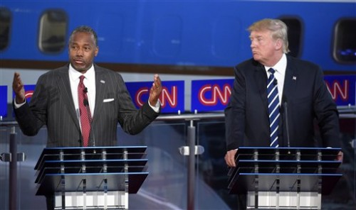 Republican presidential candidate Ben Carson, left, speaks as Donald Trump looks on during the CNN Republican presidential debate at the Ronald Reagan Presidential Library and Museum on Wednesday, Sept. 16, 2015, in Simi Valley, California. (AP Photo/Mark J. Terrill)