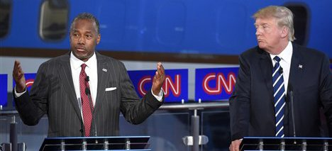 Republican presidential candidate, retired neurosurgeon Ben Carson, left, speaks as Donald Trump looks on during the CNN Republican presidential debate at the Ronald Reagan Presidential Library and Museum on Wednesday, Sept. 16, 2015, in Simi Valley, Calif. (AP Photo/Mark J. Terrill)