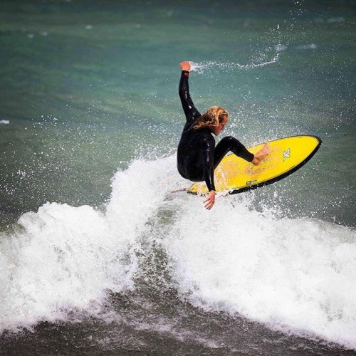 William Charles Rozier catches a wave on the coast of Lake Michigan. (Photo courtesy of Ian Jacobson.)