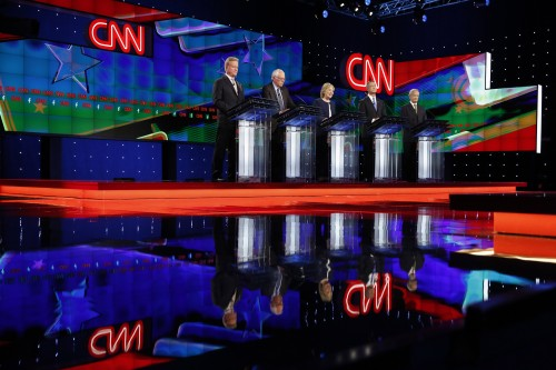 Democratic presidential candidates from left, former Virginia Sen. Jim Webb, Sen. Bernie Sanders, of Vermont, Hillary Rodham Clinton, former Maryland Gov. Martin O'Malley, and former Rhode Island Gov. Lincoln Chafee stand on stage during the CNN Democratic presidential debate Tuesday, Oct. 13, 2015, in Las Vegas. (AP Photo/John Locher)