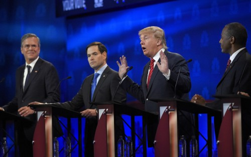 Donald Trump, second from right, speaks as Jeb Bush, left, Marco Rubio, second from left, and Ben Carson look on during the CNBC Republican presidential debate at the University of Colorado, Wednesday, Oct. 28, 2015, in Boulder, Colo. (AP Photo/Mark J. Terrill)