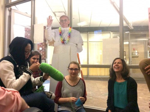 DePaul students Sarah Novosel, Jackie Posek and Elise de Bie speak to new director of Catholic Campus Ministry Amanda Thompson. (Yazmin Dominguez / The DePaulia)