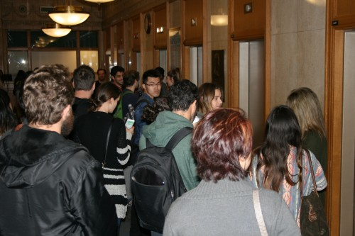 Students wait for an available elevator in the Lewis Center. The building is one of many at DePaul with elevator renovations taking place, leading to congestion during peak hours. (Mariah Woelfel / The DePaulia)