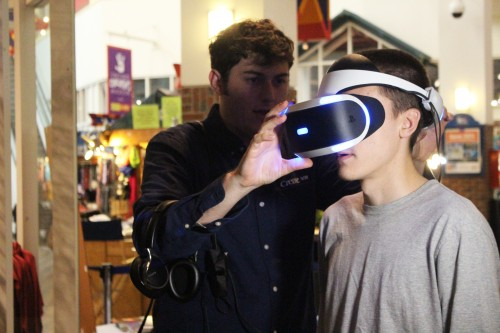 """DePaulia writer Matt Koske takes part in the virtual reality experience offered at the screening of """"The Walk."""" The film stars Joseph Gordon-Levitt as Philippe Petit, a French wire walker who walked between the Twin Towers of the World Trade Center in 1974. (Photo by Jesus J. Montero)   The DePaulia)"""