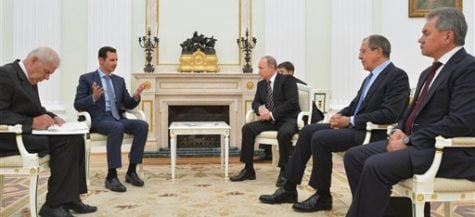 In this photo taken on Tuesday, Oct. 20, 2015, Syria President Bashar Assad, center left, gestures during his meeting with Russian President Vladimir Putin, center right, as Russian Foreign Minister Sergey Lavrov, second from right, and Russian Defence Minister Sergei Shoigu, right, listen in the Kremlin in Moscow, Russia. President Bashar Assad was in Moscow, in his first known trip abroad since the war broke out in Syria in 2011, to meet his strongest ally Russian leader Vladimir Putin. The two leaders stressed that the military operations in Syria_ in which Moscow is the latest and most powerful addition_ must lead to a political process. (Alexei Druzhinin, RIA-Novosti, Kremlin Pool Photo via AP)