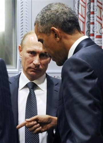U.S. President Barack Obama, right, gestures while speaking to Russian President Vladimir Putin before a bilateral meeting at United Nations headquarters in New York, Monday, Sept. 28, 2015. (Mikhail Klimentyev, RIA-Novosti, Kremlin Pool Photo via AP)